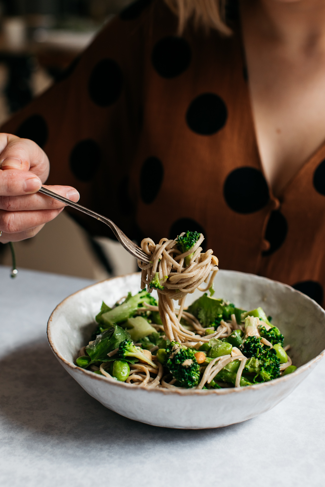 Twirling low FODMAP broccoli peanut soba noodle salad