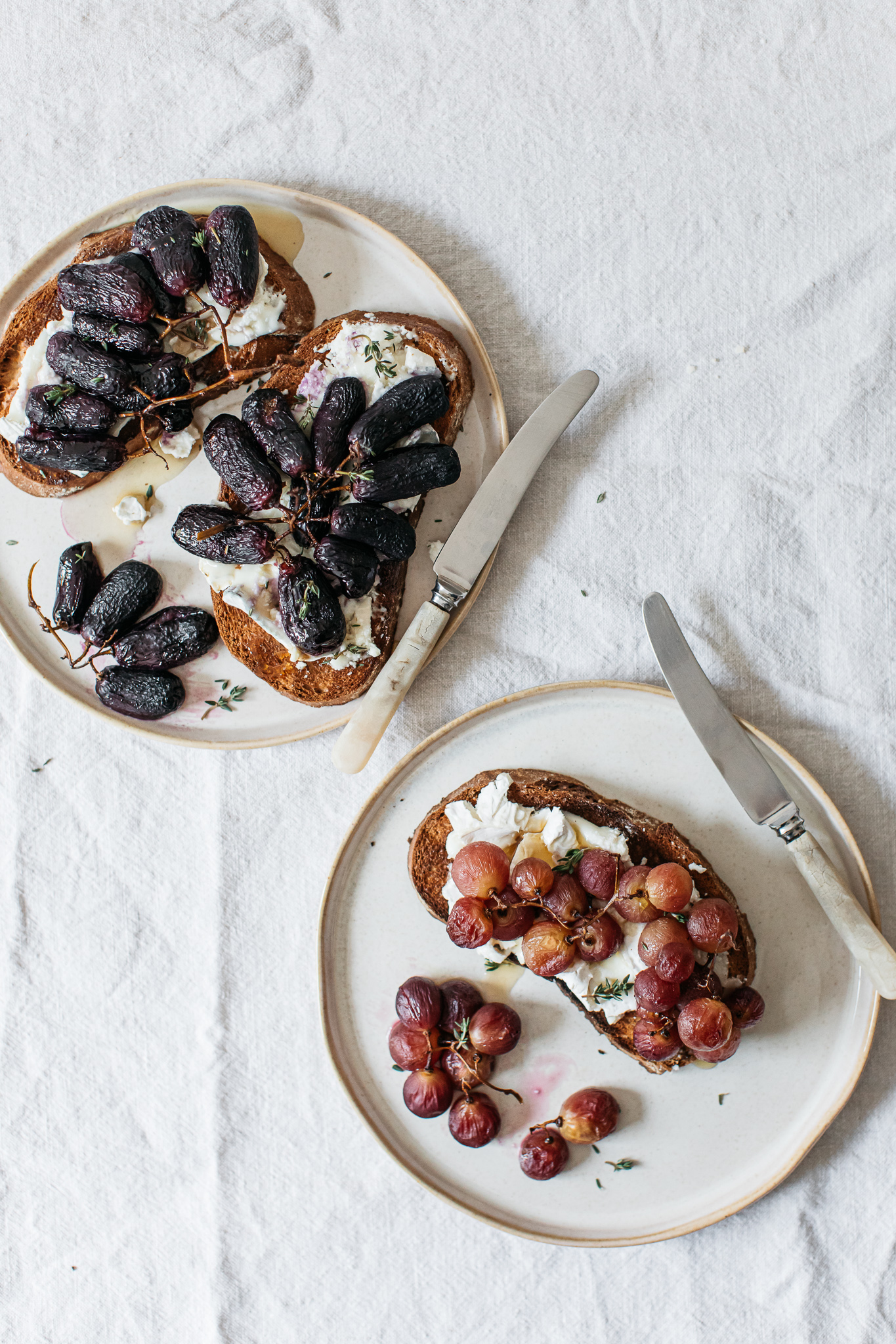 Roasted black and red grapes on gluten free goats cheese toast