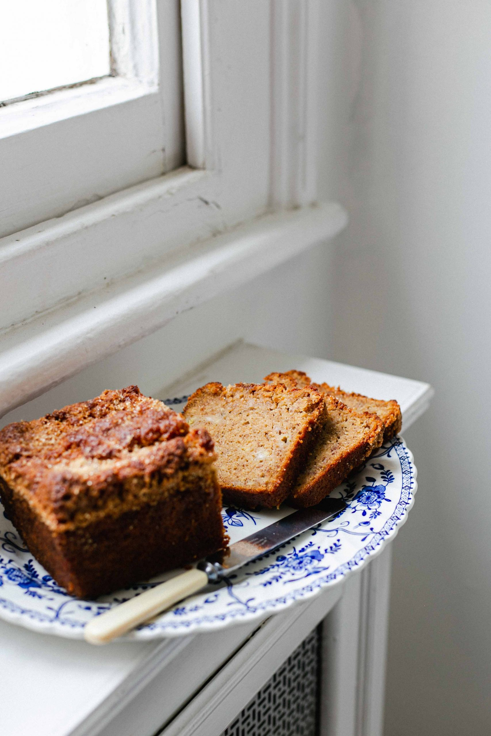 Low FODMAP banana bread on window ledge